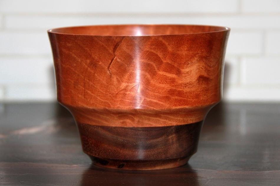 Vase of bubinga, with a walnut base.